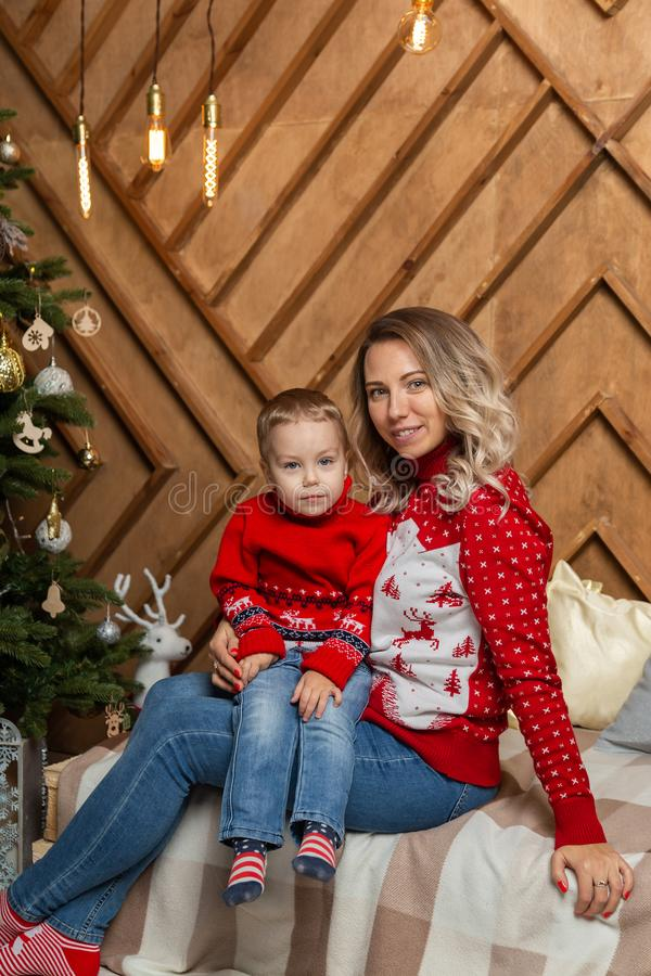 Beautiful happy woman with her son in a New Year`s decor. Happy Merry Christmas 2020. Beautiful happy women with her son in a New Year`s decor. Happy Merry stock photo