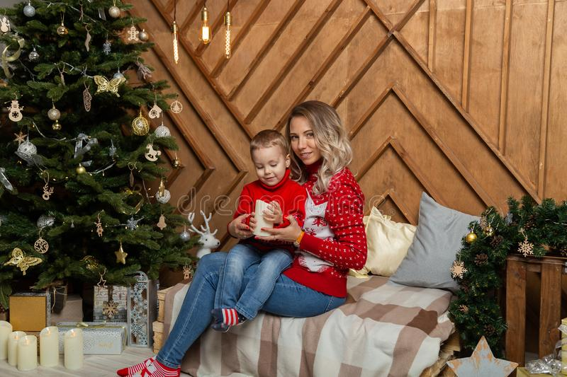 Beautiful happy woman with her son in a New Year`s decor. Happy Merry Christmas 2020. Beautiful happy women with her son in a New Year`s decor. Happy Merry stock images