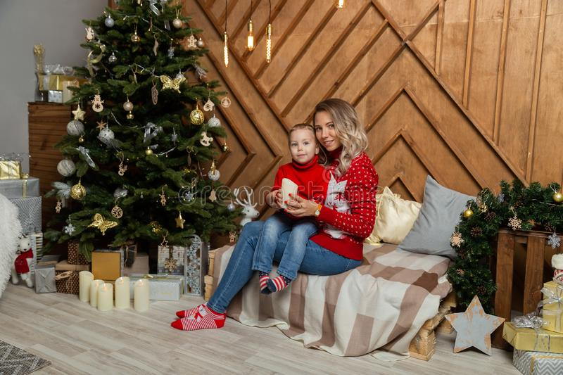 Beautiful happy woman with her son in a New Year`s decor. Happy Merry Christmas 2020. Beautiful happy women with her son in a New Year`s decor. Happy Merry stock photos