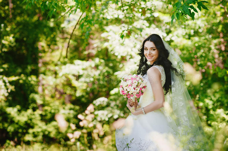 Beautiful happy young brunette bride outdoors in wedding dress,hairstyle, make-up, wedding, lifestyle stock images
