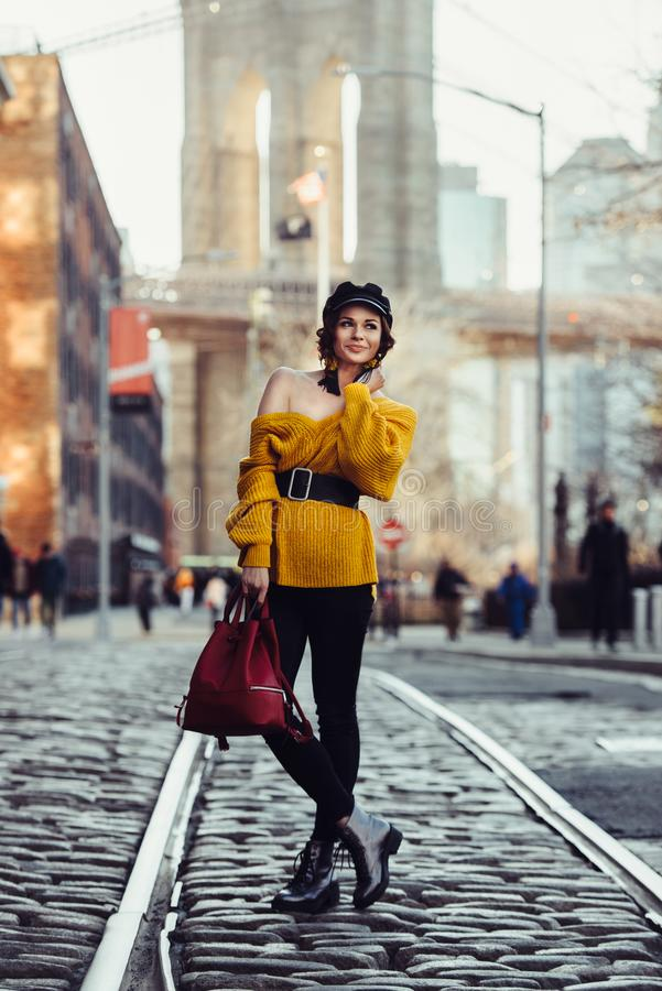 Beautiful happy young fashionable woman traveling in New York City with backpack. Tourists Lifestyle travel concept royalty free stock images