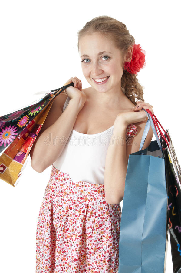 Beautiful happy young girl holding shopping gift bags. stock photo