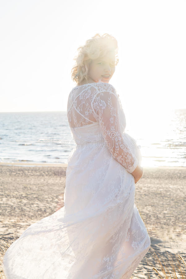 Beautiful happy young pregnant woman outdoor royalty free stock photography