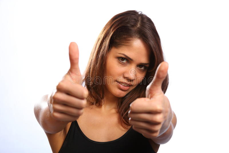 Beautiful happy young woman gives both thumbs up