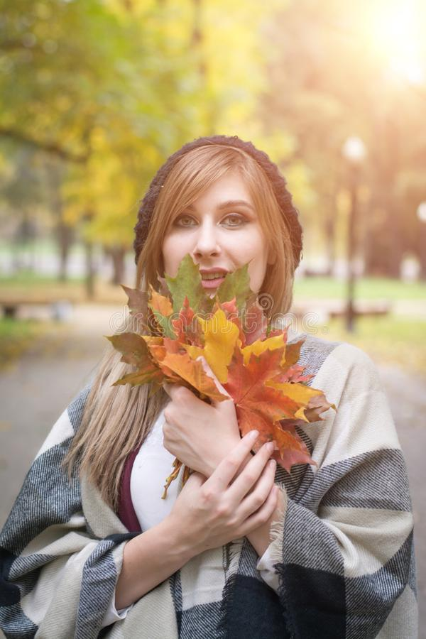 Beautiful happy young woman in park stock image