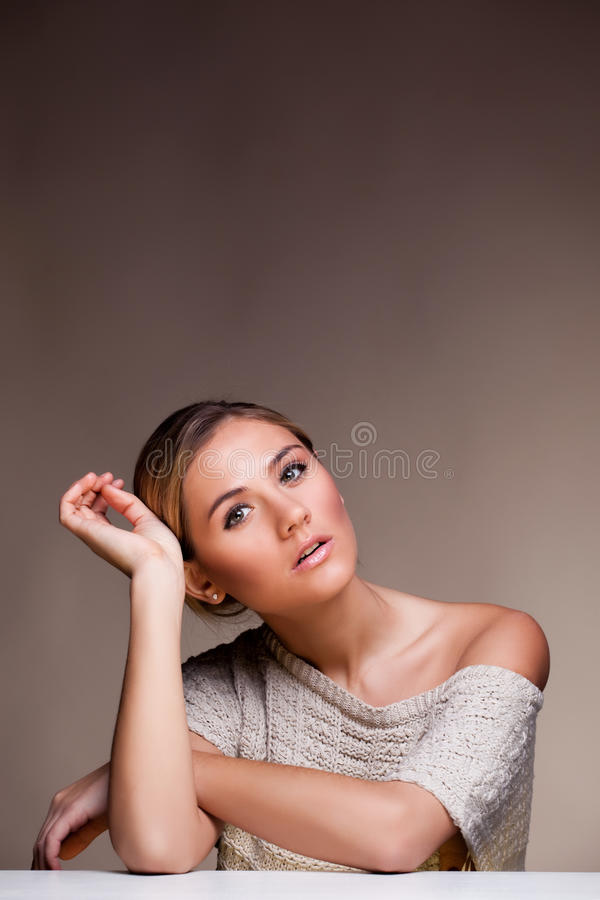 Beautiful happy young woman in sweater royalty free stock photo