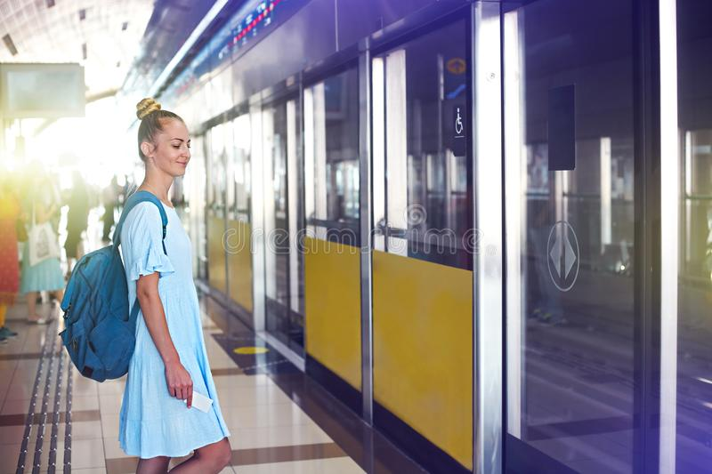 Beautiful happy young woman traveling in metro royalty free stock photos