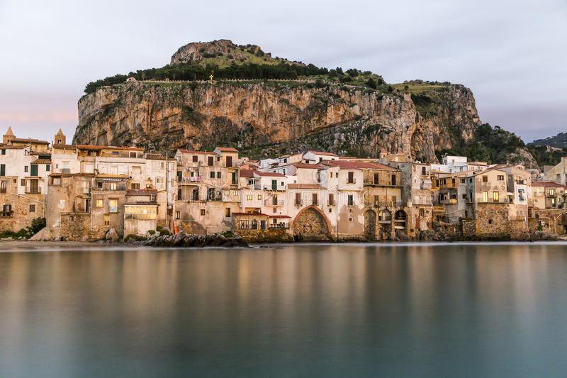 Beautiful harbor view of old houses in Cefalu at dusk, Sicily royalty free stock images