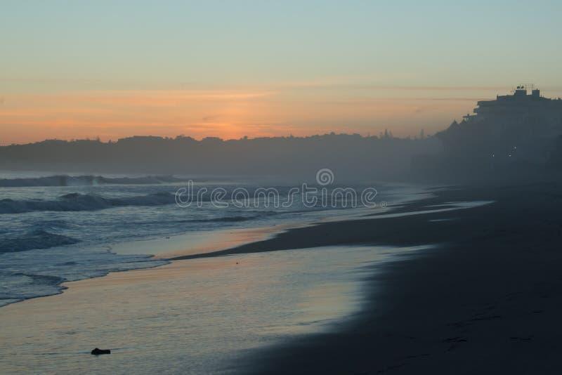 Beautiful hazy beach sunset royalty free stock images