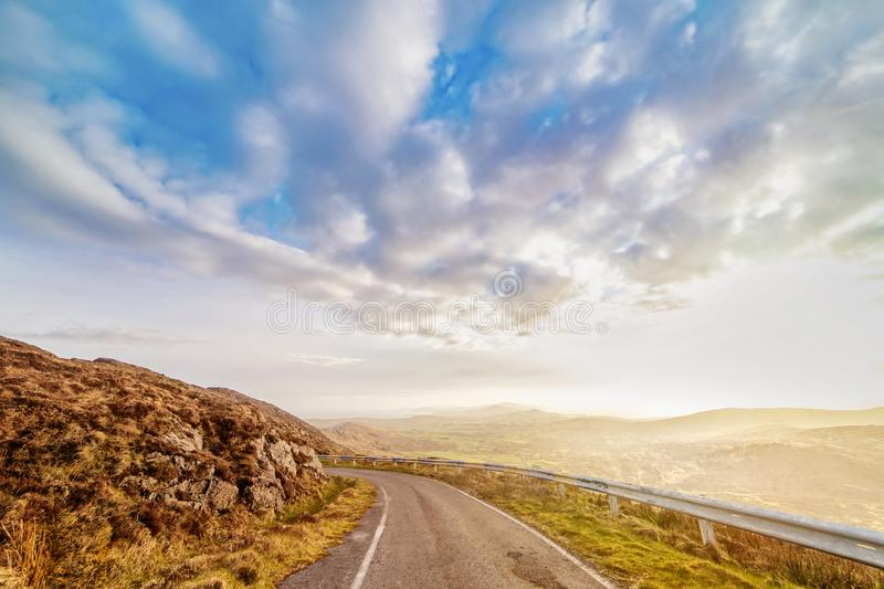 Beautiful hazy landscape with  road at the foot of the Mount Gabriel royalty free stock photos
