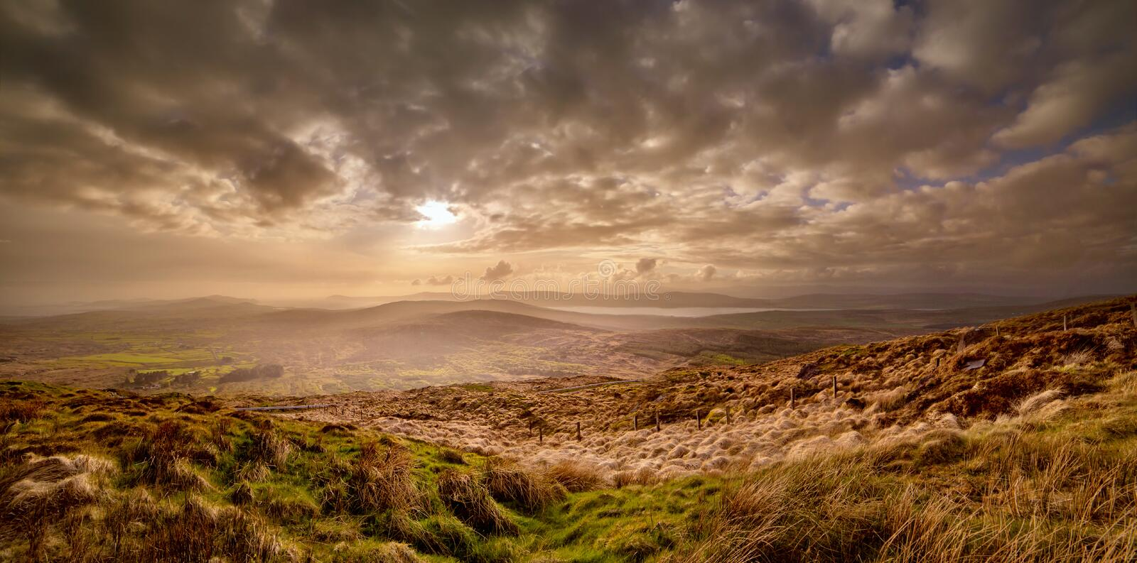 Beautiful hazy sunset at the foot of the Mount Gabriel stock photography