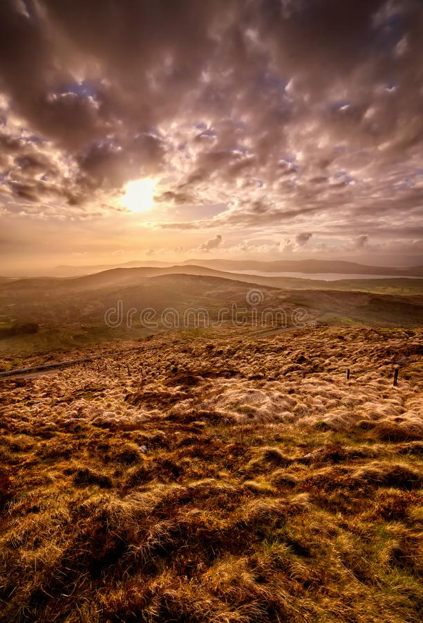 Beautiful hazy sunset at the foot of the Mount Gabriel royalty free stock photos