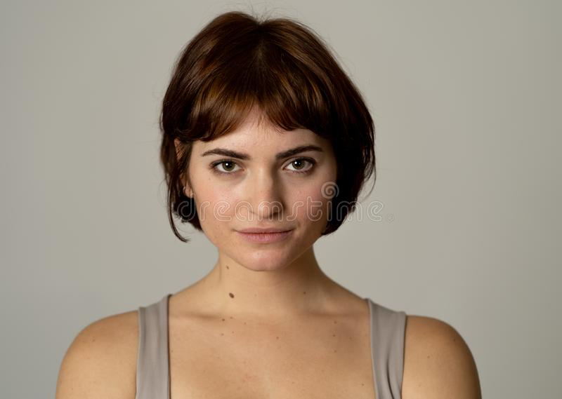 Beautiful headshot portrait of young attractive woman with stylish short hair and sensual look stock photos