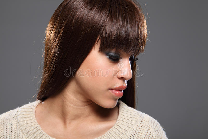 Beautiful headshot of young afro-caribbean girl royalty free stock photography