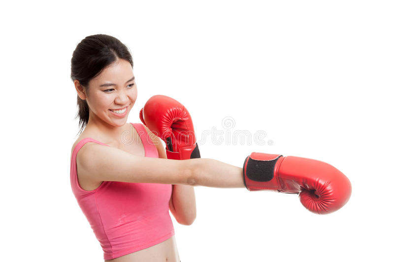 Beautiful healthy Asian girl with red boxing glove. stock image
