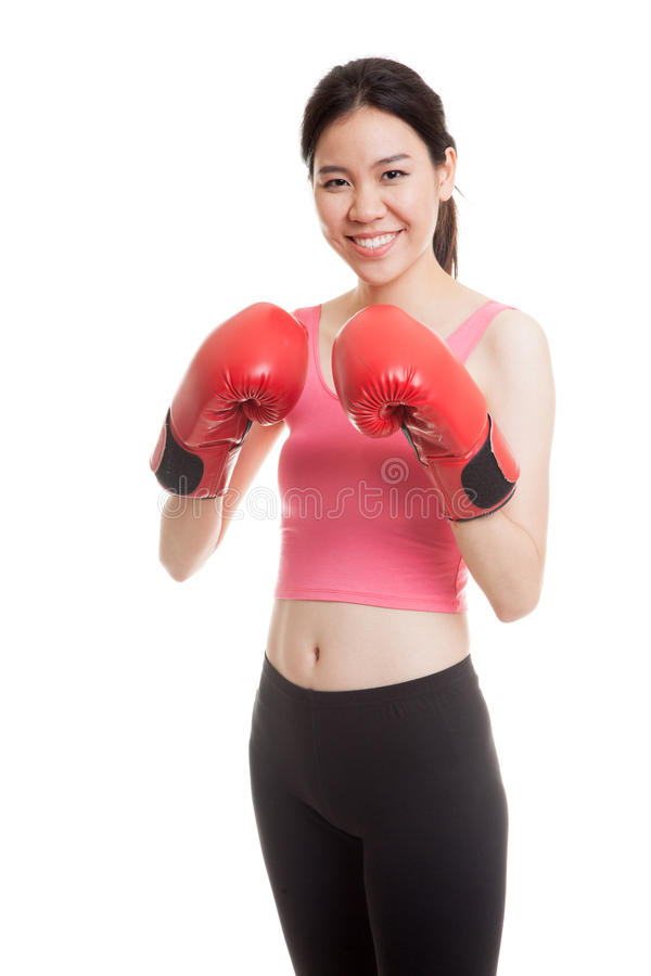 Beautiful healthy Asian girl with red boxing glove. royalty free stock image