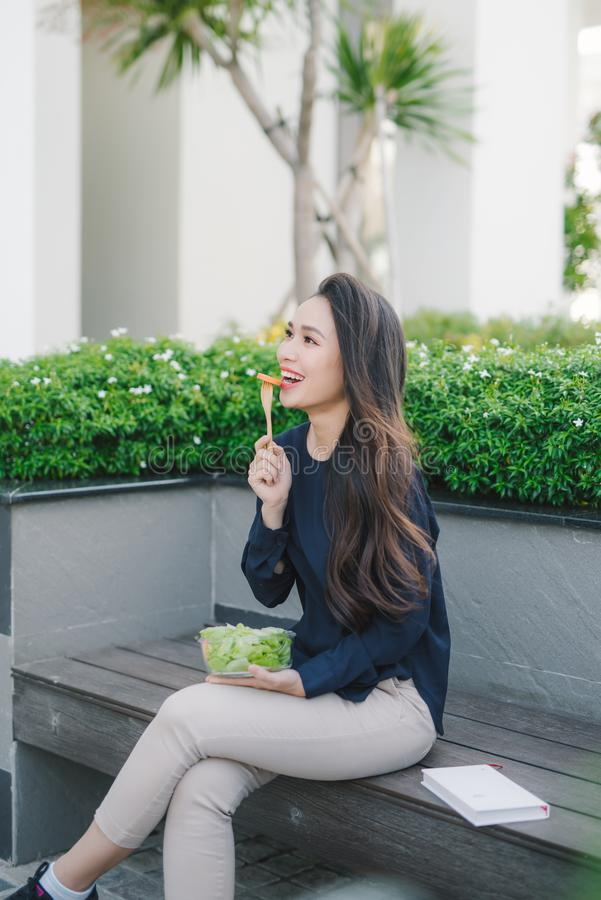 Beautiful healthy woman eating salad, Dieting Concept. Healthy Lifestyle royalty free stock images