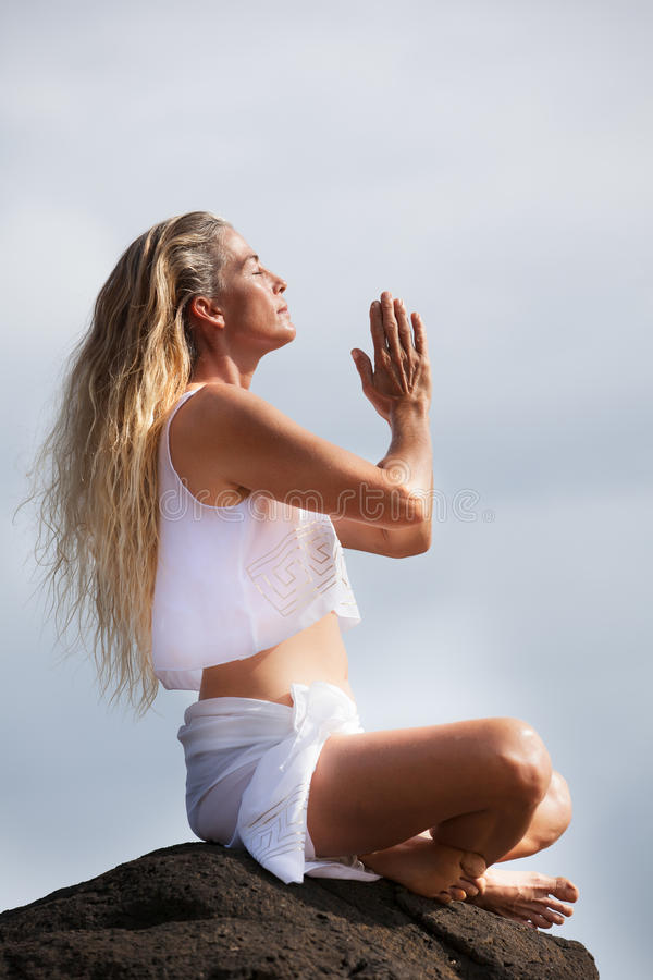 Beautiful Healthy Woman In Her Forties Meditating Royalty Free Stock Photography
