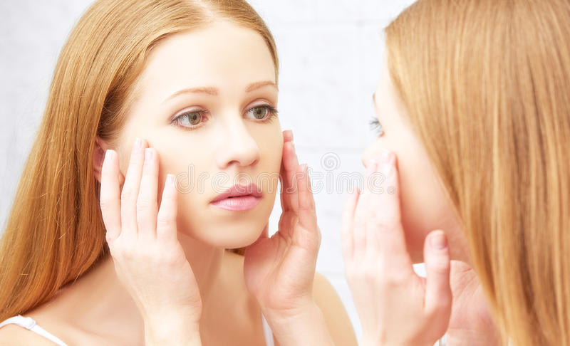 Beautiful healthy woman and mirror. Young beautiful healthy woman and the mirror stock image
