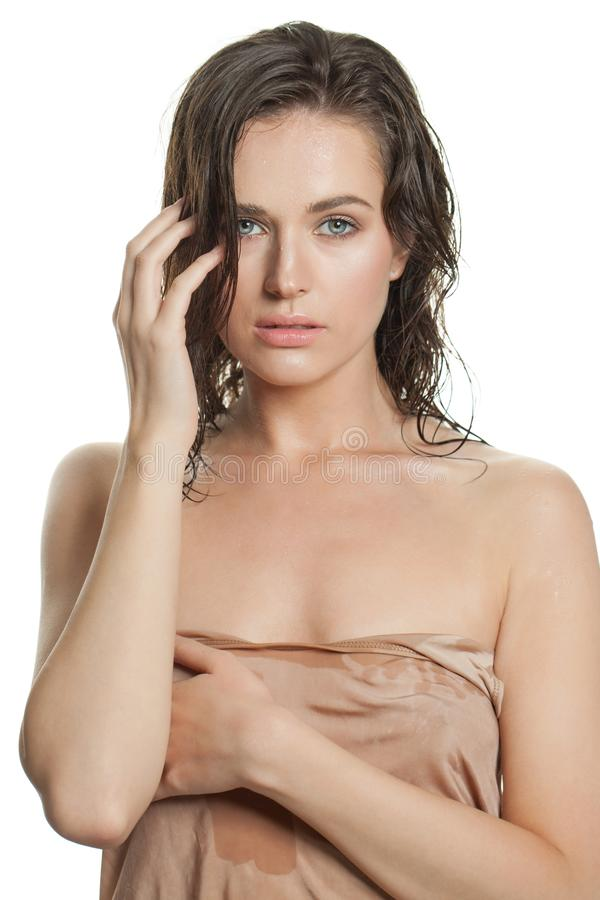 Beautiful healthy woman with wet skin after bath isolated.  royalty free stock photography