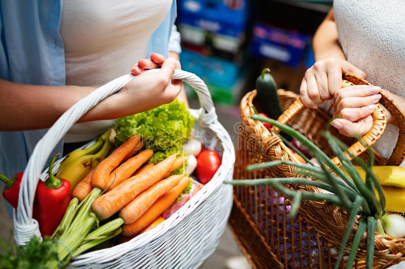 Beautiful happy women shopping vegetables and fruits stock photo