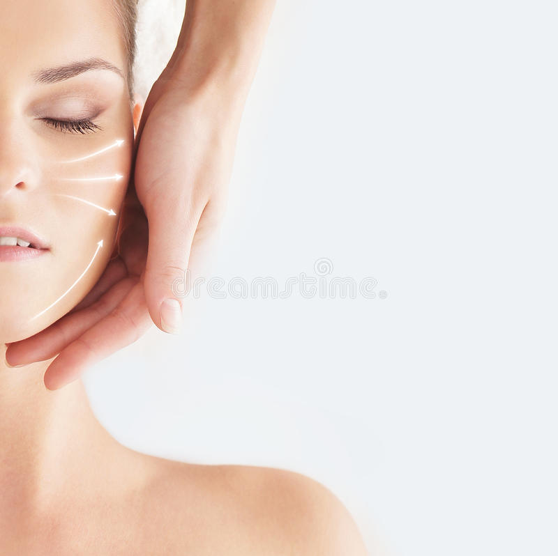 Beautiful, healthy and young woman is getting spa treatment (concept with the arrows) stock photo