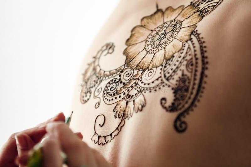 Mehndi Patterns : Beautiful henna patterns in process of applying stock photo