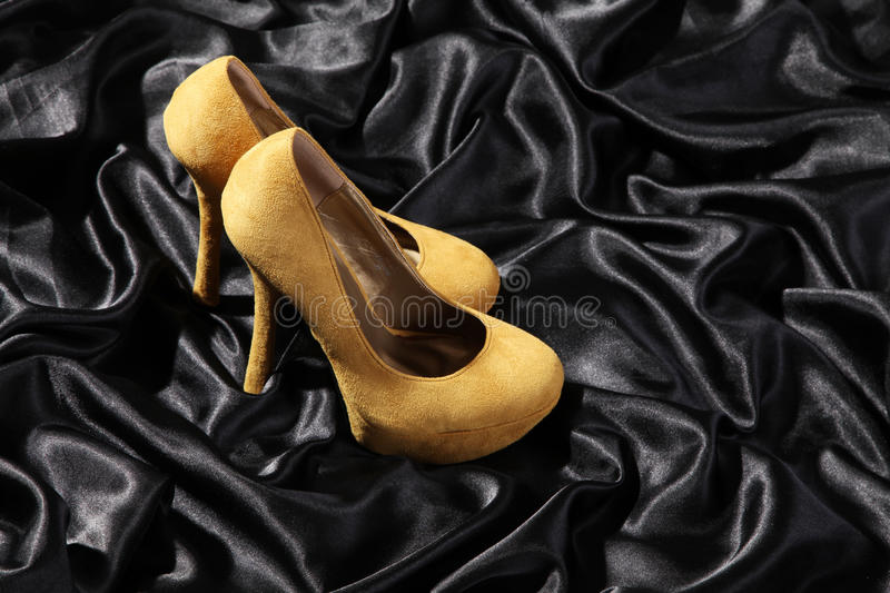Beautiful high heels on satin stock photography