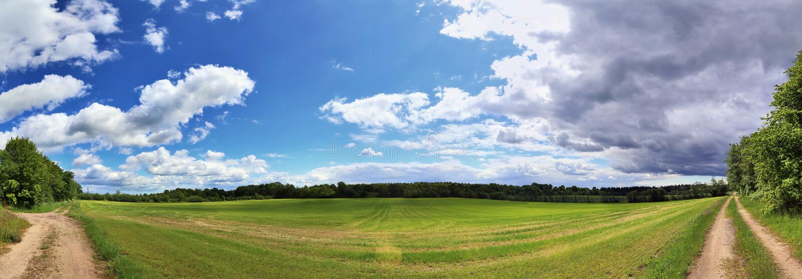 Beautiful high resolution summer landscape with fields, green grass and a stunning summer sky taken in northern germany. Beautiful high resolution summer royalty free stock photo