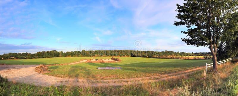 Beautiful high resolution summer landscape with fields, green grass and a stunning summer sky taken in northern germany. Beautiful high resolution summer stock photo