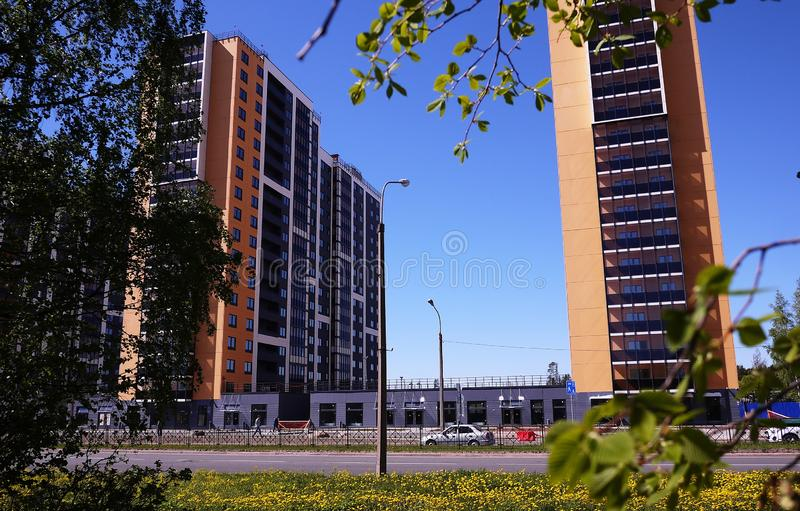 Beautiful high-rise house. High-rise apartment building. Details of the glass facade. Details and close-up. royalty free stock photos