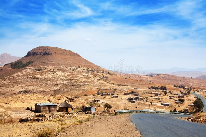 Beautiful highland valley landscape, scenery panoramic view, road and village in Drakensberg mountains, Lesotho, Southern Africa. Beautiful highland valley stock image