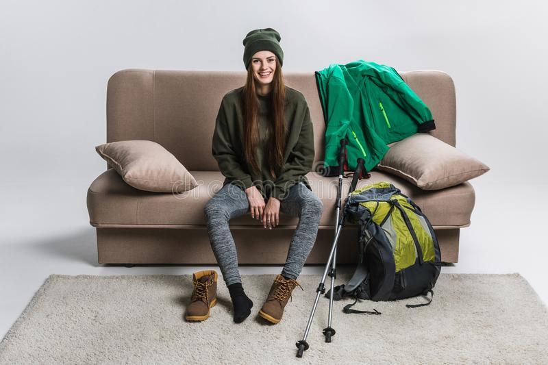 Beautiful hiker wearing hiking boots and warm clothing. At home royalty free stock photos