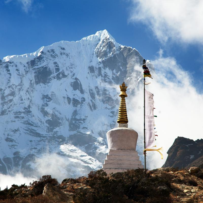 Beautiful himalayas with buddhist stupa and prayer flags royalty free stock images