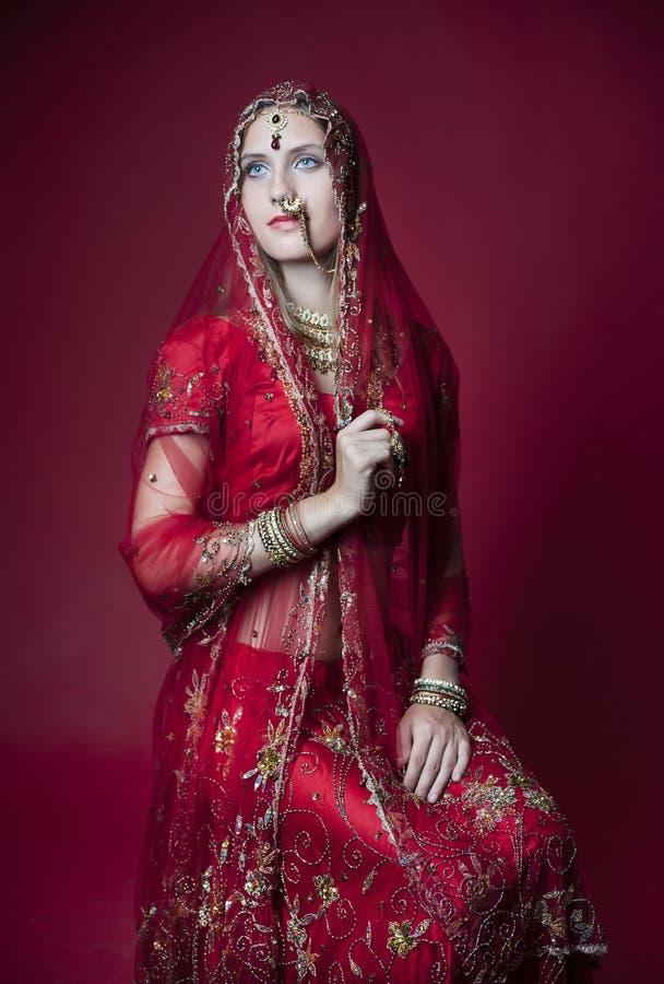 Beautiful hindu bride. Beautiful and royal hindu bride. Intense colors and details stock image