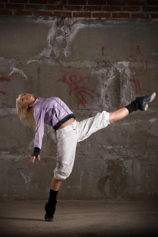 Download Beautiful Hip Hop Girl Dancing Over Grey Wall Stock Photo - Image: 11960254
