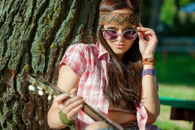 Beautiful hippie girl. With guitar stock image