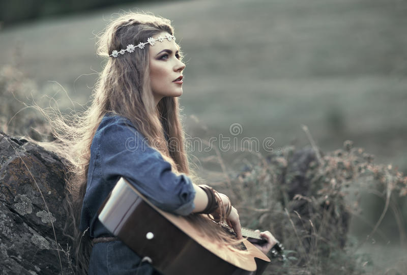 Beautiful hippie girl with guitar stock photography