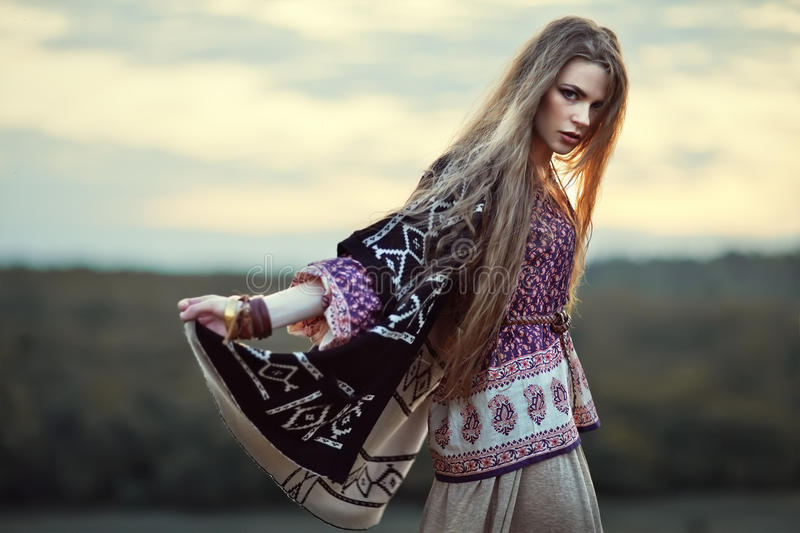 Beautiful hippie girl. Outdoors at sunset. Boho fashion style royalty free stock photos