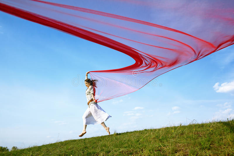 Beautiful hippie girl with red fabric stock photo