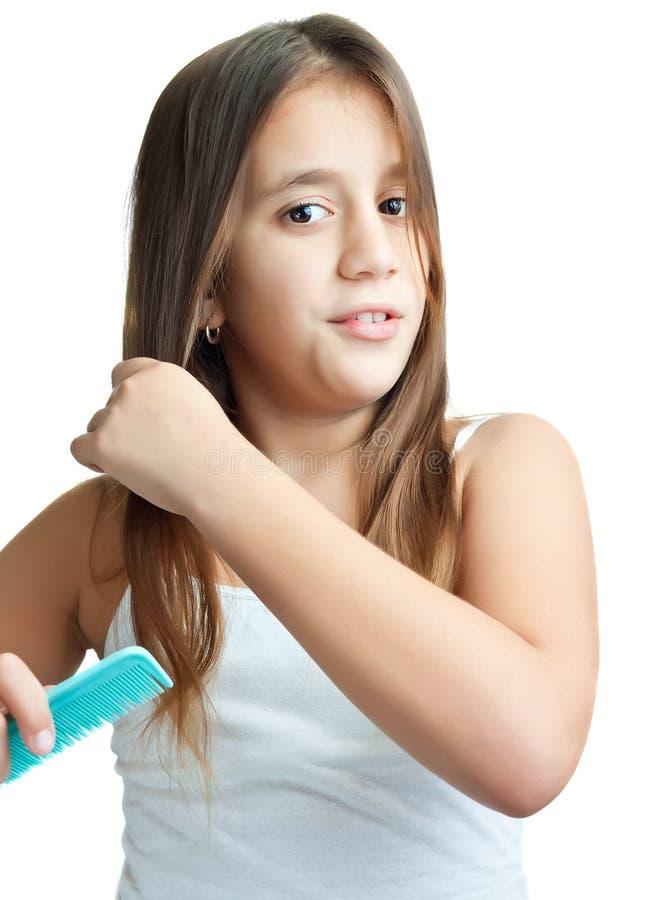Download Beautiful Hispanic Girl Combing Her Hair Stock Photo - Image: 22710296