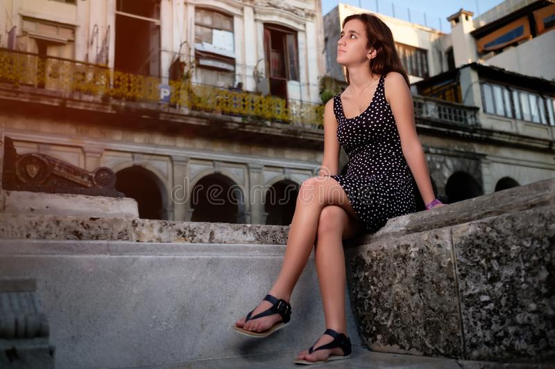 Beautiful hispanic girl in Havana with an urban decay backgroun royalty free stock photo