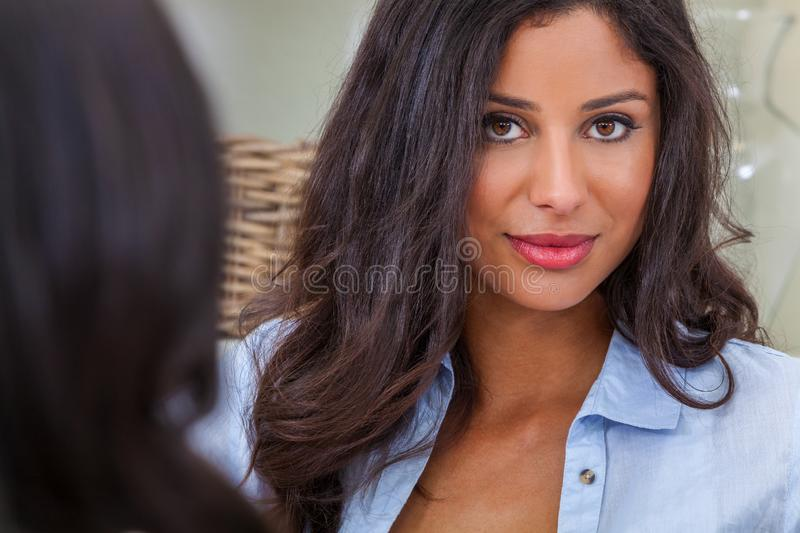 Beautiful Hispanic Latina Woman Looking to Camera With A Friend royalty free stock photography