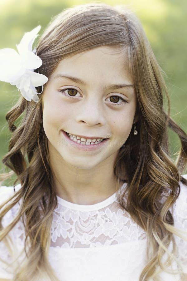 Beautiful hispanic little girl portrait. Vertical posed photo royalty free stock photography