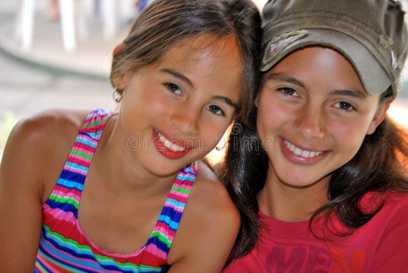 Beautiful Hispanic Sisters stock images