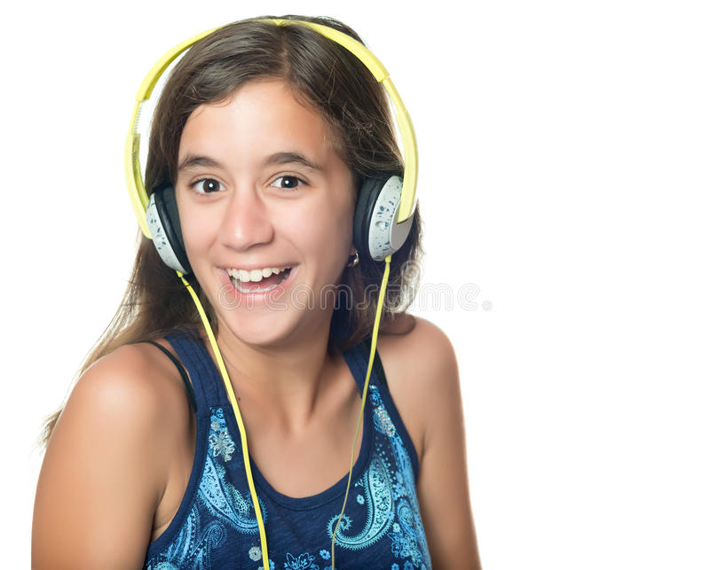 Beautiful hispanic teenager listening to music stock photo