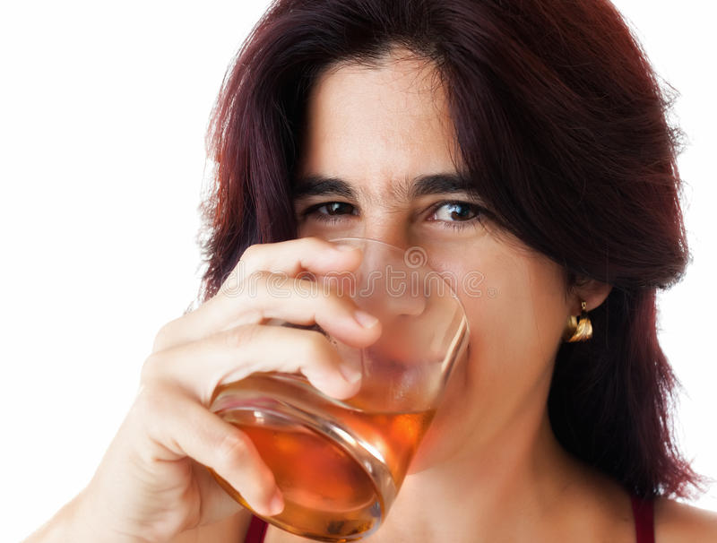 Beautiful hispanic woman drinking whisky stock images
