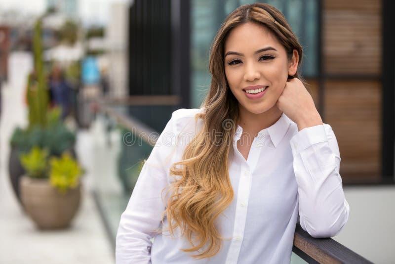 Beautiful hispanic woman professional portrait headshot, casual smile, cheerful, positive, optimistic, joyful smile stock images