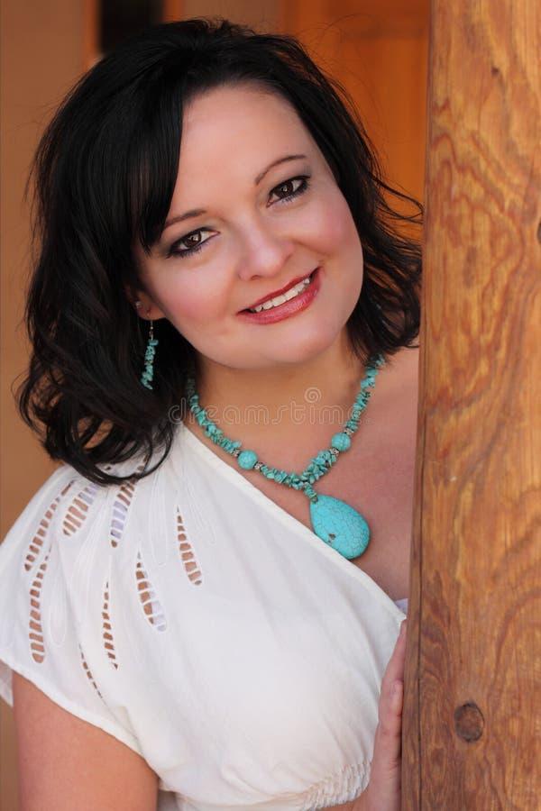 Beautiful Hispanic Woman Wearing Turquoise royalty free stock photos
