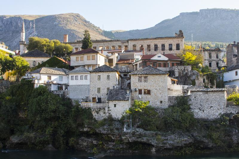 Beautiful historic houses on the banks of the Neretva River in the Old Town of Mostar. Bosnia and Herzegovina.  stock photo
